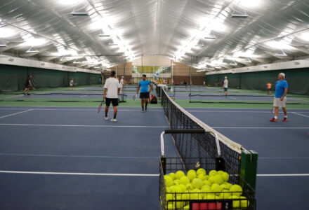 Playing in the tennis house