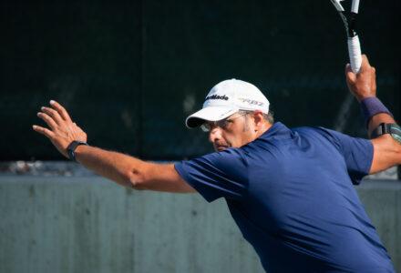 Man playing tennis at the Salt Lake Tennis and Health Cluib